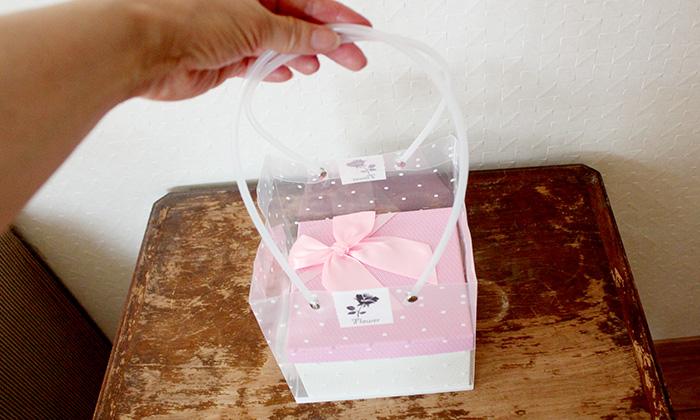 持ち手付きの透明ビニールバッグの写真