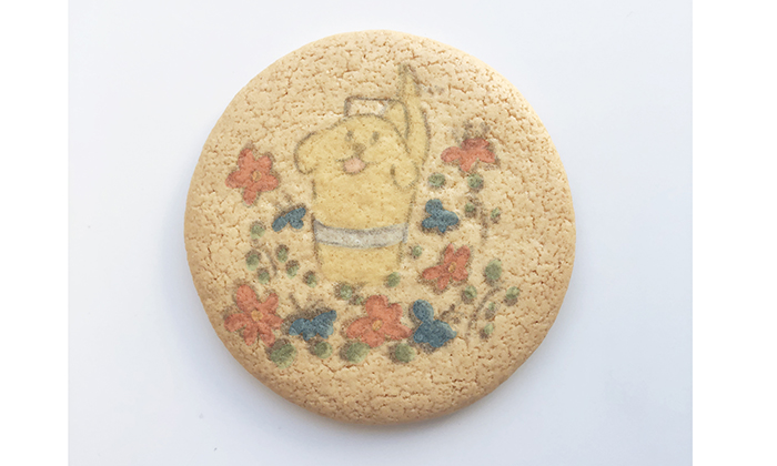 お花畑にいる盲導犬イラストのプリントクッキーの写真